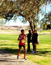 Ali Upshaw runs in cross country meet for St. Michael