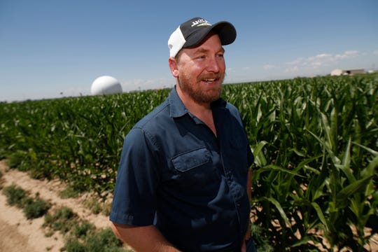 In this Thursday, July 11, 2019, photograph, Kendall DeJonge of the United States Department of Agriculture is shown at a research farm northeast of Greeley, Colo. Researchers are using drones carrying imaging cameras over the fields in conjunction with stationary sensors connected to the internet to chart the growth of crops in an effort to integrate new technology into the age-old skill of farming.
