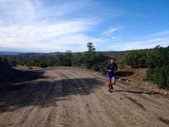 St. Michael girls cross-country runner Ali Upshaw runs on a mountain on her Navajo reservation