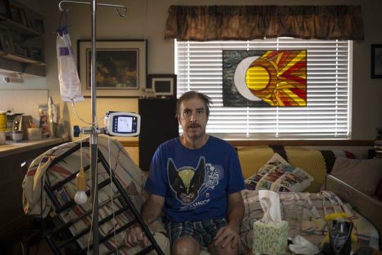 A portrait of Robert Letscher on Aug. 7, 2019, in the living room of his Mesa home.