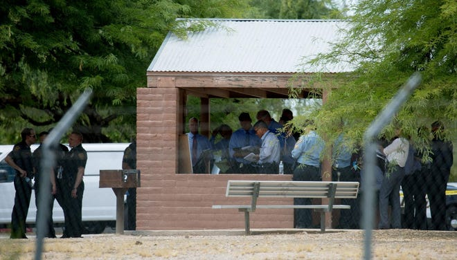 Officers and detectives from the Tucson Police Department investigate an officer involved shooting at Fort Lowell Park on Aug. 14, 2019.