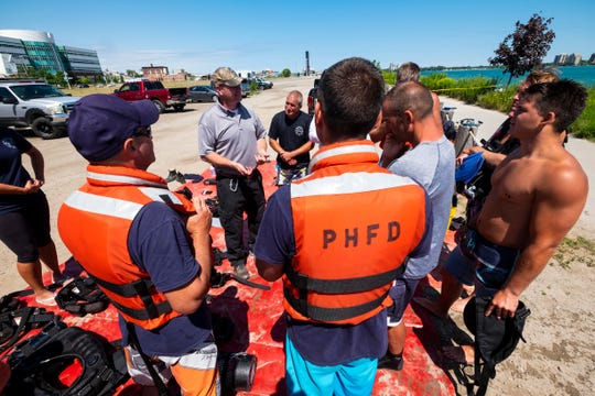 Richard Brackin, an instructor from Dive Rescue International, speaks to a group of Port Huron firefighters during a public safety dive rescue training session Wednesday, Aug. 14, 2019.