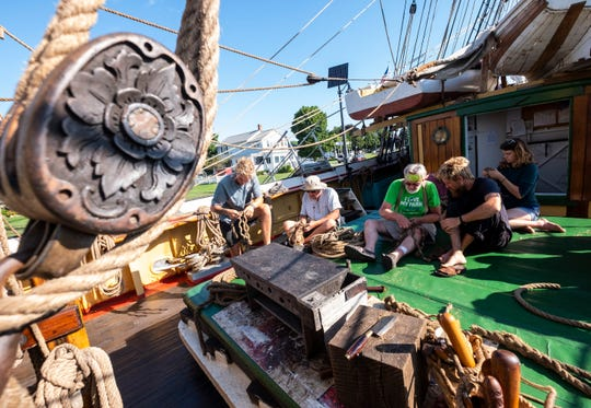 Crewmembers aboard the Picton Castle work to splice rope on the main deck of the ship Wednesday, Aug. 14, 2019, while docked in Algonac. The crew is a mix of staff and volunteers. Their time is divided between working and resting hours.