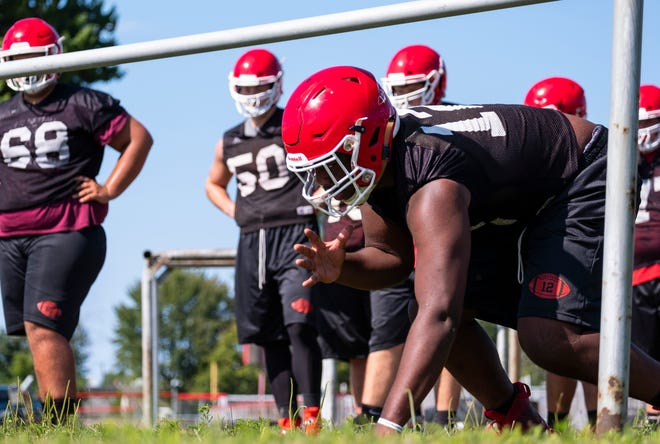 Port Huron defensive end Malik Davis waits for the signal to start a drill during practice Tuesday, Aug. 13, 2019, at Port Huron High School.