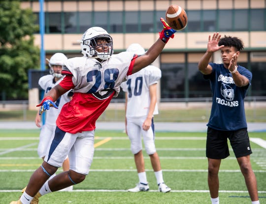 Chambersburg's Keyshawn Jones breaks up a pass during a defensive backs drill at Trojan Stadium on Wednesday, August 14, 2019.