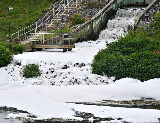 A foamy substance flows down the Codorus Creek moving away from York Wastewater Treatment Plant in Manchester Township, Wednesday, Aug. 14, 2019. Dawn J. Sagert photo