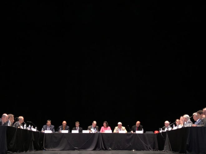 A panel of state senators, along with school and business officials, debate school property tax elimination at a Tuesday, Aug. 13 Senate Majority Policy Committee meeting.