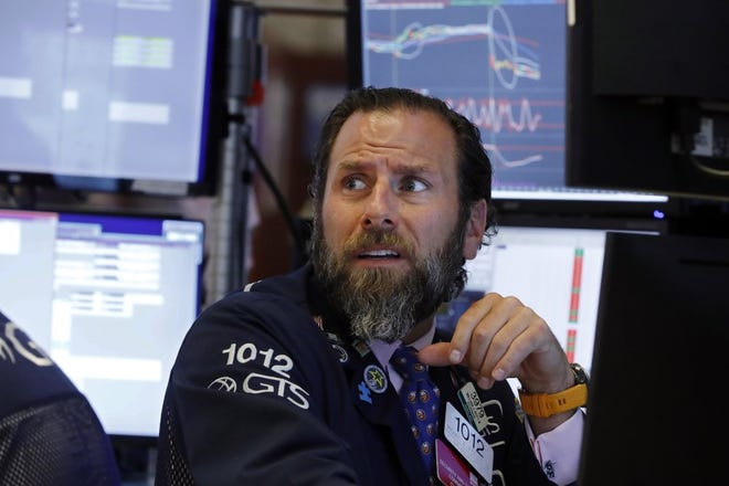 Specialist Micael Pistillo works at his post on the floor of the New York Stock Exchange, Wednesday, Aug. 14, 2019. Stocks are falling sharply after the bond market threw up another warning flag on the economy. (Photo by Richard Drew)