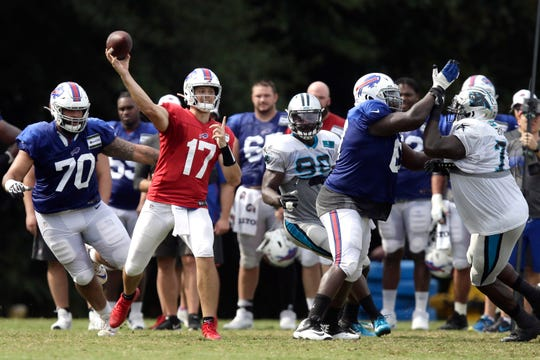 Buffalo Bills quarterback Josh Allen (17) passes against the Carolina Panthers during an NFL football training camp practice Wednesday in Spartanburg, S.C.