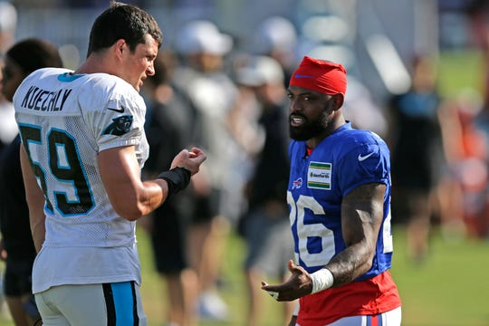 Carolina Panthers' Luke Kuechly (59) and Buffalo Bills cornerback Captain Munnerlyn chat during an NFL football training camp practice in Spartanburg, S.C., Wednesday.