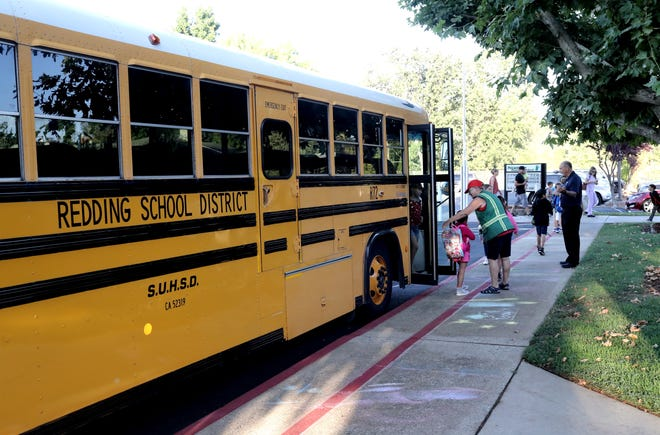 A bus lets students off at Sycamore Elementary School in Redding on the first day of school Wednesday, Aug. 14, 2019.
