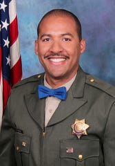 California Highway Patrol officer Andre Moye Jr. is pictured in this undated photo released by the CHP. A driver stopped by police pulled out a rifle and opened fire Monday, Aug. 12, 2019, killing Moye and wounding other officers during a shootout on a freeway overpass that left the gunman dead and sent terrified motorists running for cover.