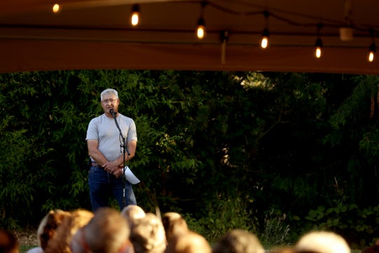 Dave Hayden tells his story during the Salem Storytellers Project: Outdoors at Gilgamesh Brewing in Salem on Aug. 13, 2019.
