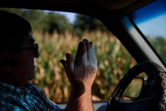"Richard Wilkins describes how his struggling corn crop needs rain as he sits in his truck next to a cornfield in his Greenwood, Del., farm July 29, 2019. ""We're trying to do what we can,"" said Wilkins, who shuns the federal farm habitat programs, but hopes that leaving what weeds and wildflowers survive in hard-to-mow areas helps wildlife."