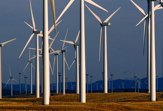A wind turbine farm owned by PacifiCorp near Glenrock, Wyo. Bigger, more efficient equipment will allow a western U.S. electric utility to redevelop an aging Wyoming wind farm with far fewer turbines while generating the same amount of power.