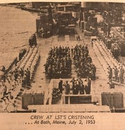 The crew of the USS Tom Green County (LST 1159) muster on deck during a christening ceremony  in 1953. Most of the Terrebonne Parish-class ships in the US Navy were named for counties.