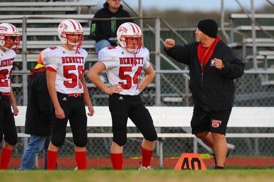 Bennett High School head football coach Glenn Gibson with his defense against Stephen Decatur.