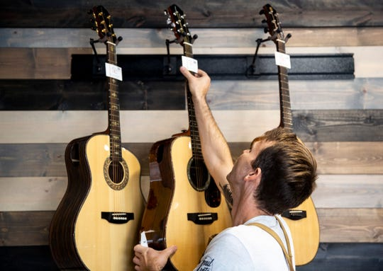 Josh Rieck, owner of J Rieck Music, repairs instruments out of his shop, Wednesday, Aug. 14. Rieck has repaired and built stringed instruments for 15 years and has made over 60 pieces.