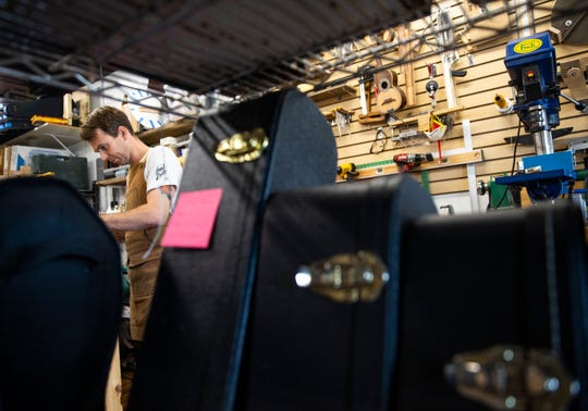 Josh Rieck crowns the frets on the neck of a guitar in his shop, J Rieck Music, Wednesday, Aug. 14. Rieck has repaired and built stringed instruments for 15 years and has made over 60 pieces.