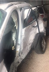 Photo shows the damage to Rosemary Melton's Ford Escape after she crashed with a Battlefield police vehicle.