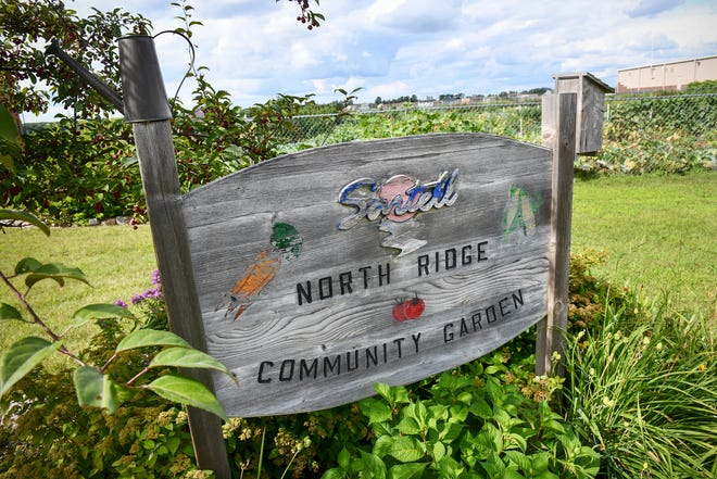 A sign marks the location of the North Ridge Community Garden Wednesday, Aug. 14, in Sartell.