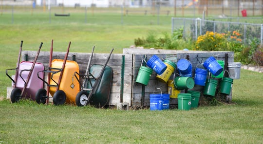 Buckets and wheelbarrows are ready for use at the North Ridge Community Garden Wednesday, Aug. 14, in Sartell.
