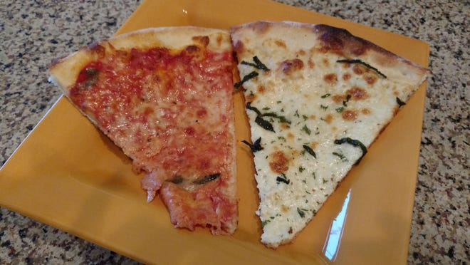 Experience the best of both worlds with a slice of Davila's Pizza's white roasted garlic pizza and a slice of traditional pizza pie.