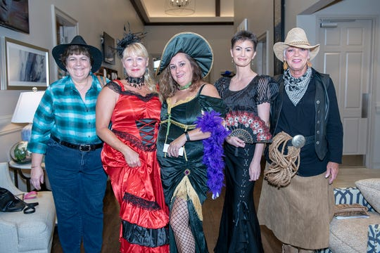 Joan Pitman, left, Lisa Barrett, Christina Stamper, Sandi Smith and Sharon White at the Wild West Murder Mystery benefiting Madison's Miracles at Aycock at Tradition.