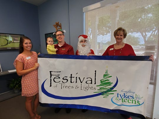 Courtney Buckel, left, Emma Moriarty, Dr. Brian Moriarty, Mrs. Santa (Paula Hundt) and Cathleen Owens kick off the announcement of the Grand Reindeer for the 12th annual Tykes & Teens Festival of Trees & Lights on Nov. 17-23 at Flagler Place in downtown Stuart.