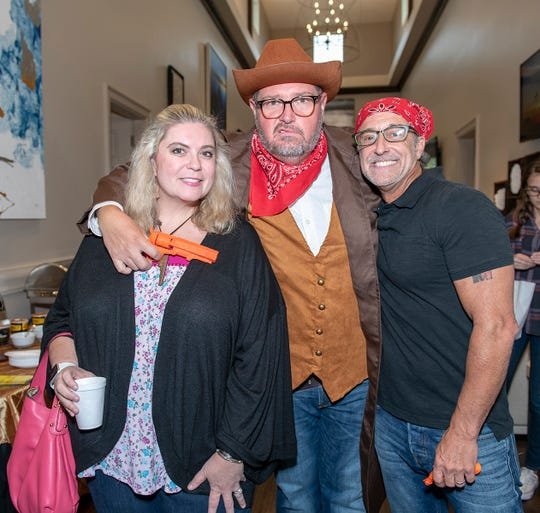 Tara Biek Robinson, left, Rob Robinson and Mike Renfro at the Wild West Murder Mystery benefiting Madison's Miracles at Aycock at Tradition.