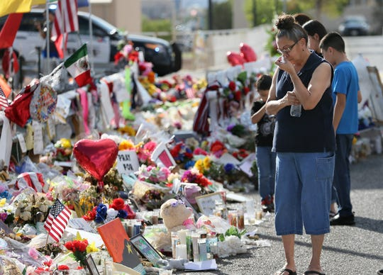 El Pasoans continue to mourn while visiting the makeshift memorial outside the Walmart near Cielo Vista Mall.