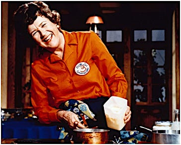 "Julia Child wears a patch for L'ecole des Trois Gourmands (The School of the Three Happy Eaters) while on the set of her PBS cooking show, ""The French Chef."" The school was founded in Paris, France, in the 1950s by Child and Simone Beck and Louisette Bertholle, her co-authors for ""Mastering the Art of French Cooking."""