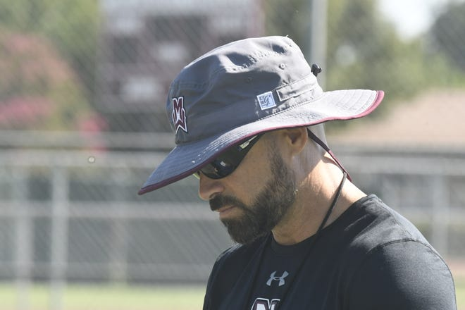 Mt. Whitney head coach Nathan Chamberlain played in two Cowhide games in the 1990s.