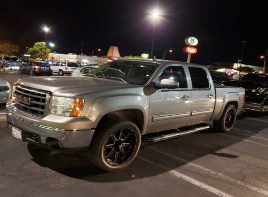 A light gray 2007 GMC Sierra 1500 with black and chrome rims  was reported stolen on Aug. 8, 2019.