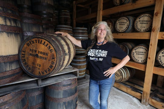 Stacy Cohen, the owner of the Stray Cat Gallery, at Catskill Distilling Co., at the Dancing Cat Saloon in Bethel, New York, is pictured in the distilleries aging room on her property, Aug. 13, 2019.