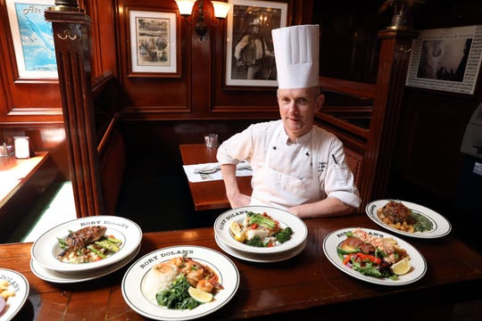 Chef Benny Roddy with some of the signature dishes at Rory Dolan's Restaurant & Bar in Yonkers Aug. 12, 2019.