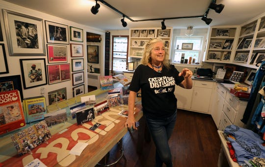 Stacy Cohen, the owner of the Stray Cat Gallery, at Catskill Distilling Co., at the Dancing Cat Saloon in Bethel, New York, is pictured in one of the gallery spaces on her property, Aug. 13, 2019.