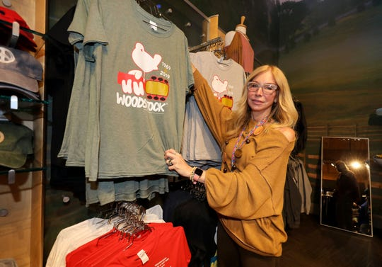 Joan York-Walsky, with Sky Retail Partners, the owner of the Bindy Bazaar Museum Shop at the Bethel Woods Center for the Arts in Bethel, New York, Aug. 13, 2019.