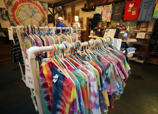 Handmade tie-dyed shirts are pictured at the Woodstock Oasis country store in Bethel, New York, Aug. 13, 2019.