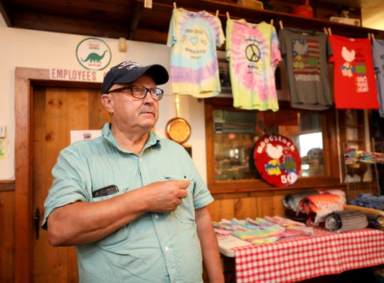 Fred Humphrey from San Diego, California, talks about the original Woodstock concert, while shopping at the Woodstock Oasis country store in Bethel, New York, Aug. 13, 2019.