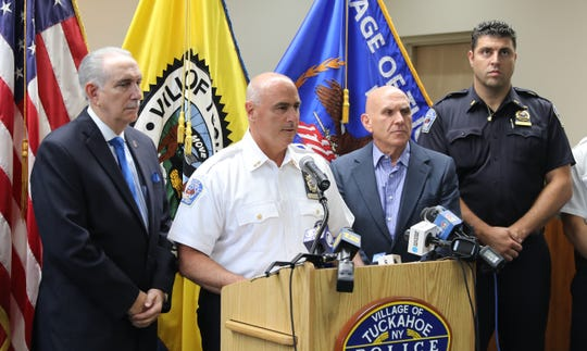 Tuckahoe Police Chief John Costanzo, center, talks about the arrest of a 47-year old male for multiple criminal possessions of weapons charges, during a press conference Aug. 14, 2019.