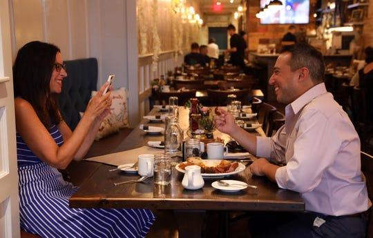 Food and dining reporter Jeanne Muchnick takes a picture of Yonkers native RJ Puma at Eileen's in Yonkers Aug. 12, 2019. Puma, the former owner of Anna Artuso's Pastry Shop and the past president of the McLean Avenue Merchant's Association, gave Muchnick a tour of his favorite foodie spots on Mclean Avenue.