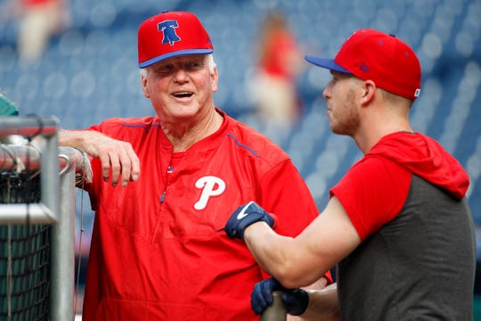 Philadelphia Phillies batting coach Charlie Manuel, left talks with Corey Dickerson, right, during batting practice before the first inning of a game against the Chicago Cubs, Wednesday in Philadelphia.