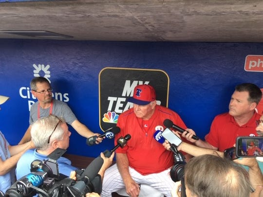 Charlie Manuel answers questions in the Phillies dugout from the media on Wednesday before his first game as hitting coach.