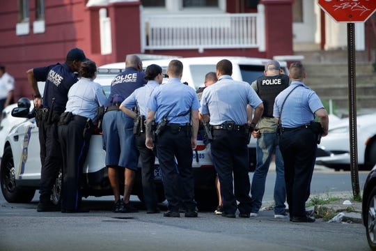 Philadelphia police stage as they respond to an active shooting situation, Wednesday in the Nicetown neighborhood of Philadelphia.