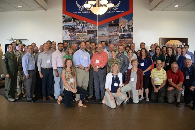 Representatives from Sheppard Air Force Base, other military installations and area wind energy companies pose for a photo at Sheppard Air Force Base, Aug. 8. The group was meeting  to discuss a variety of topics ranging from improving communication and relationships between wind industry companies, Department of Defense and local communities; technology and more.