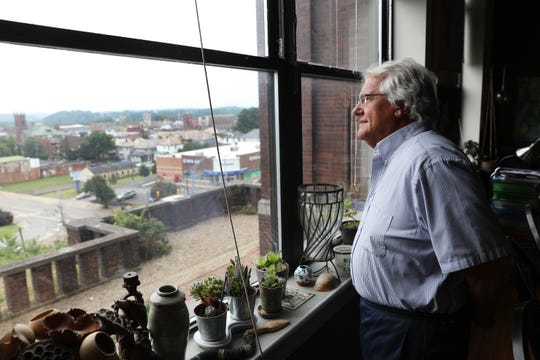 Dave Mitzel looks out over Zanesville from his home in the former Pioneer School. Mitzel is sponsoring the The Katherine Mitzel Challenge to encourage investments in the arts in Zanesville.