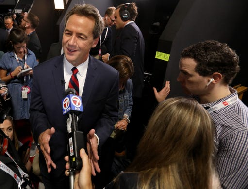 Montana Governor Steve Bullock talks with the media in the spin room after the Democratic Presidential debate at the Fox Theatre in Detroit, Michigan on Tuesday, July 30, 2019. Bullock announced his candidacy on May 14, 2019.
