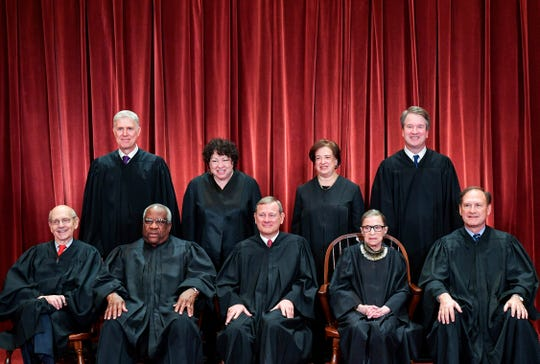 Chief Justice John Roberts sits in the middle for the Supreme Court's official photo, Nov. 30, 2018.