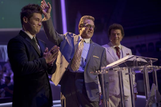 Jesse Gemstone (John Goodman), center, addresses his megachurch congregation as he's flanked by his sons, Kelvin (Adam Devine), left, and Jesse (Danny McBride), in HBO's 'The Righteous Gemstones.'
